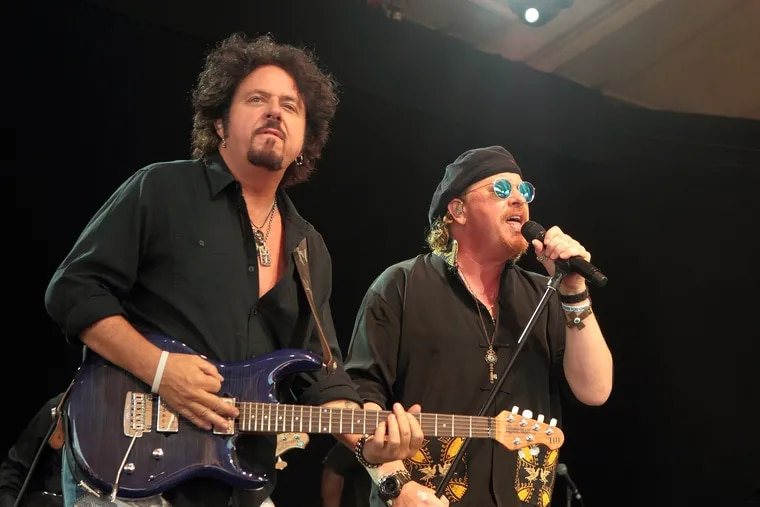 Steve Lukather, left, and Joseph Williams of the band Toto performs in concert at Pier Six Pavilion on Wednesday, Aug. 12, 2015, in Baltimore.
