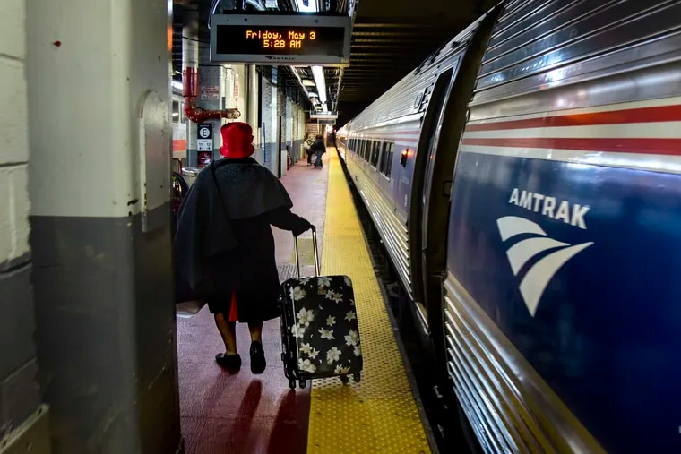 """Rev. Georgiette Morgan-Thomas heads on the platform at Penn Station in New York to board the Amtrak #89 train which leaves at 5:51 a.m. May 3, 2019. As less people travel due to the coronavirus, Amtrak has """"taken aggressive measures to cut costs to minimize employee and service impacts."""""""