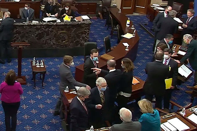 Senate Minority Leader Mitch McConnell (R.,Ky.), lower center-right, and other Republican senators and staff talk on the Senate floor after a vote Saturday on whether to allow witnesses in the second impeachment trial of former President Donald Trump. The Senate ultimately acquitted Trump on Saturday, a coda, at least for now, to his tumultuous four years in office.