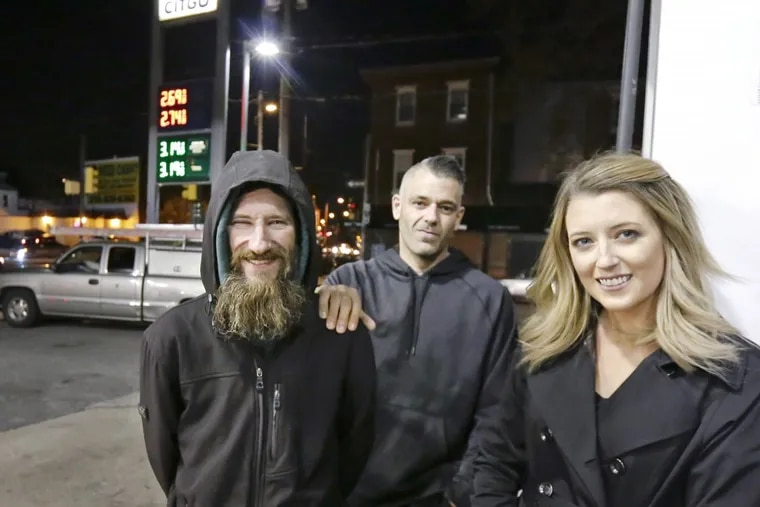 Johnny Bobbitt Jr. (left), Mark D'Amico, and Kate McClure at the CITGO station where Bobbitt spent his last $20 to buy gas for McClure.