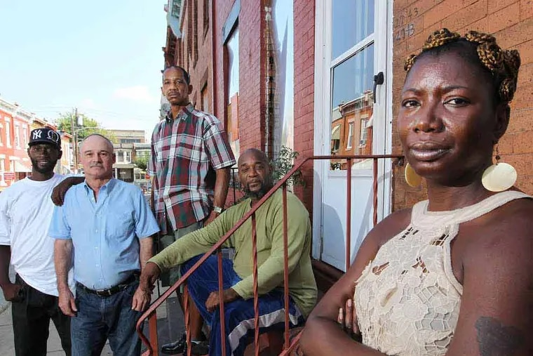 Letitia Mack (right) at the recovery house with residents (from left) Wilson Marrow, Gary Doughty, James Flowers, and Tony Haile. (Michael Bryant/Staff Photographer)