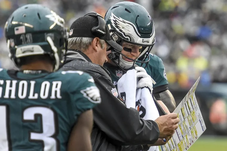 Eagles quarterback Carson Wentz and head coach Doug Pederson during the game against the San Francisco 49ers at Lincoln Financial Field Oct. 29, 2017.