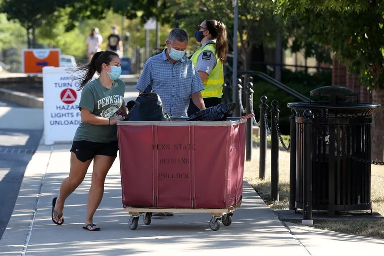 Penn State University freshmen move their belongings to their resident hall on the University Park campus on Aug. 18, 2020. Freshmen were assigned a specific day and time for their move-in due to Covid-19 restrictions. CRAIG HOUTZ / For the Inquirer