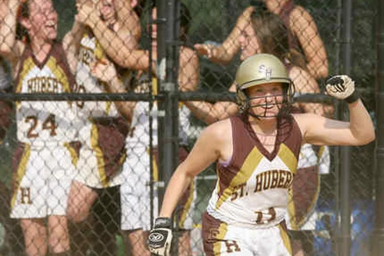 St. Hubert's sophomore Kathleen MacFeeters, who entered the game as a pinch-runner, celebrates after scoring what turned out to be the only run of the game in the seventh inning.
