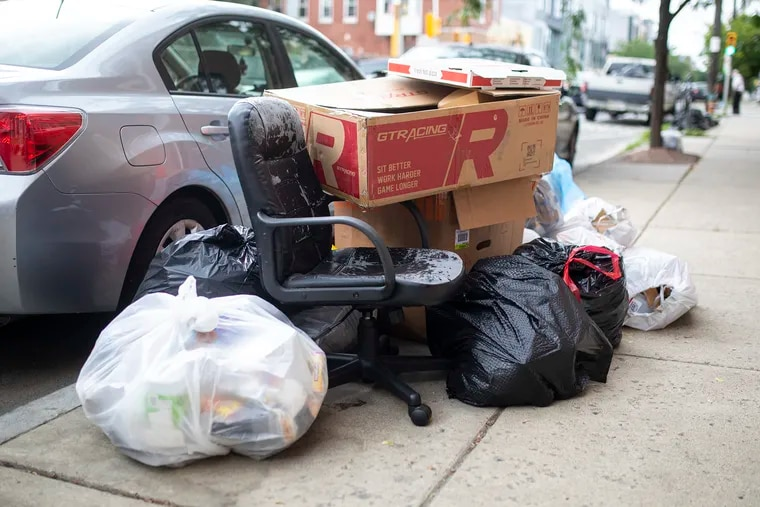 Uncollected trash sits along Frankford Avenue in Philadelphia's Fishtown neighborhood on Friday, July 17, 2020.