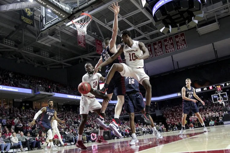 Temple's Shizz Alston (10) tries a wrap-around pass to teammate Ernest Aflakpui (24) against Penn.