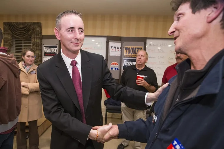 Brian Fitzpatrick (left) is congratulated at Republican headquarters in Doylestown on Election Night in 2016.