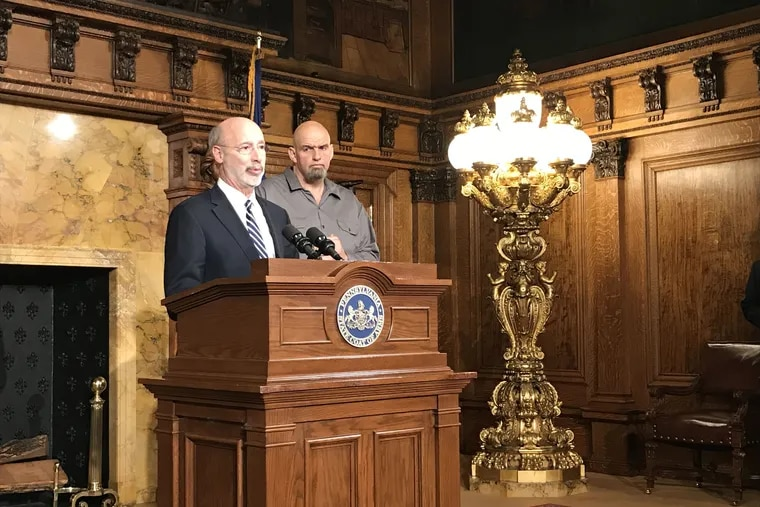 Gov. Tom Wolf, left, and Lieutenant Gov. John Fetterman, right, both Democrats, announce plans for a statewide listening tour aimed at gauging the public's interest on legalizing recreational marijuana. The two appeared together at a press conference in the state Capitol on Thursday, Jan. 24, 2019.