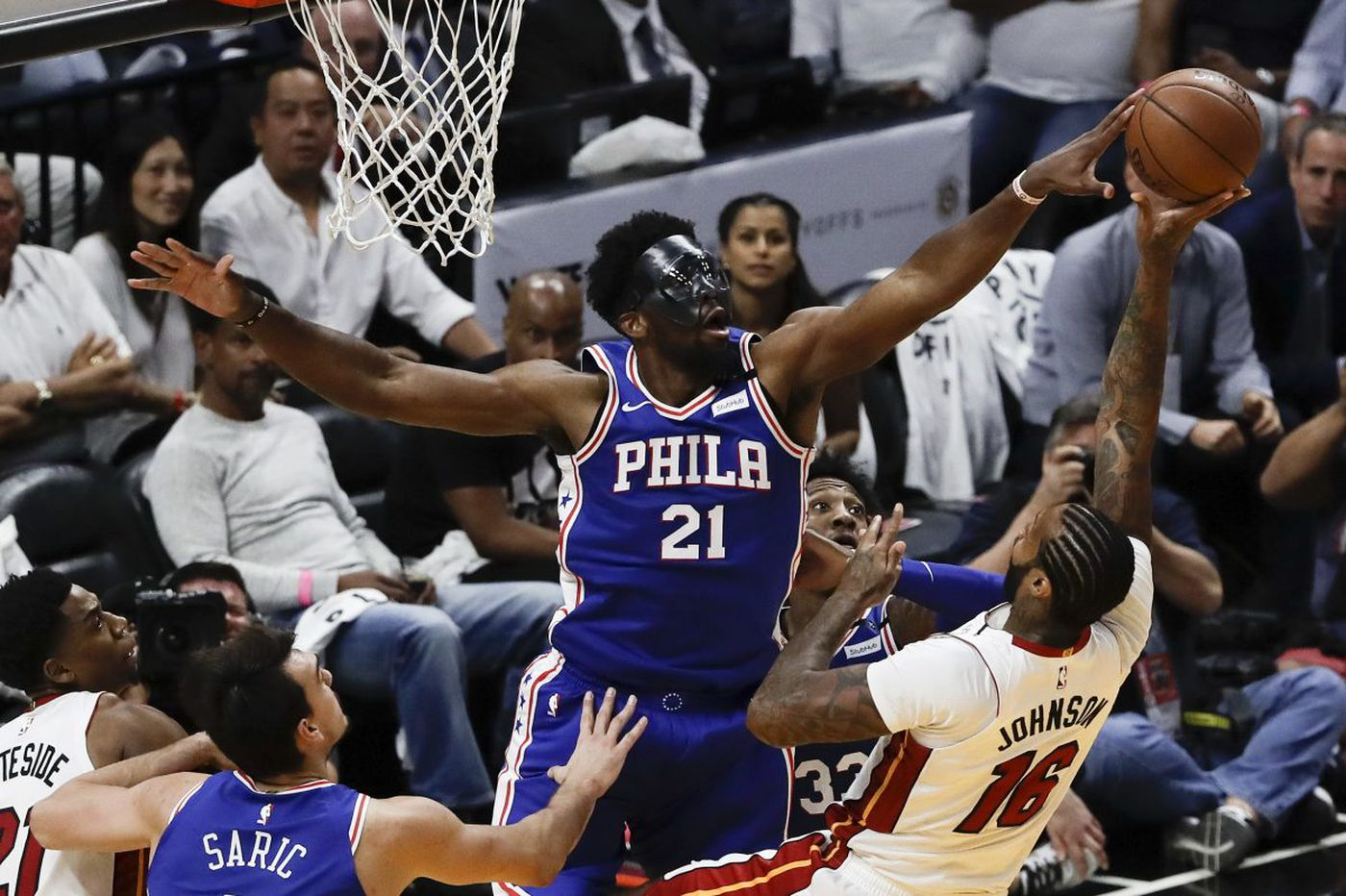Joel Embiid leads Sixers to NBA playoff victory over Heat in first game back