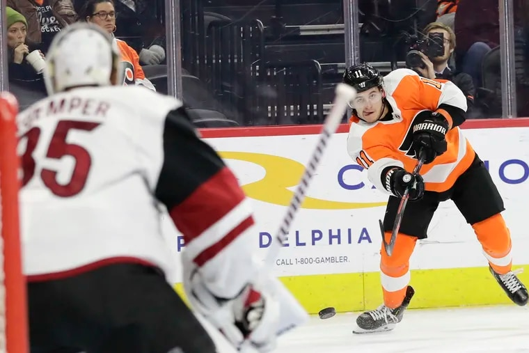 Right winger Travis Konecny, shooting the puck against Arizona Coyotes goaltender Darcy Kuemper, will return to the Flyers' lineup Tuesday.