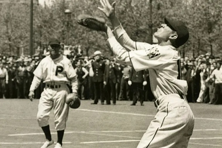 On May 10, 1939, after several misses Phillies' rookie catcher Dave Coble, 26-years-old, caught a ball tossed from Philadelphia's City Hall Tower 500 feet above him as a publicity stunt for the team. (Philadelphia Bulletin photo)