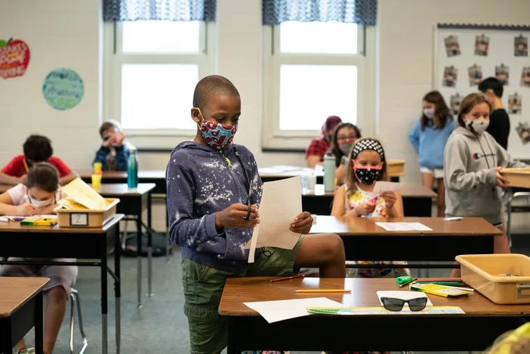More districts are enacting mask mandates as COVID-19 cases rise and the start of the school year looms. In this September 2020 file photo, students at Lower Gwynedd Elementary School wear masks inside their classroom.