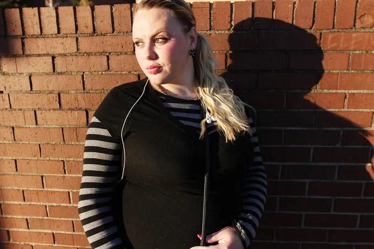 Tiffany Anderson poses near 8th and Girard in Philadelphia on November 12, 2014. ( DAVID MAIALETTI / Staff Photographer )