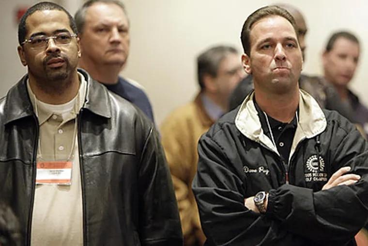 United Auto Workers union members listen to a speech by union president Ron Gettelfinger in Detroit. (Paul Sancya/AP)