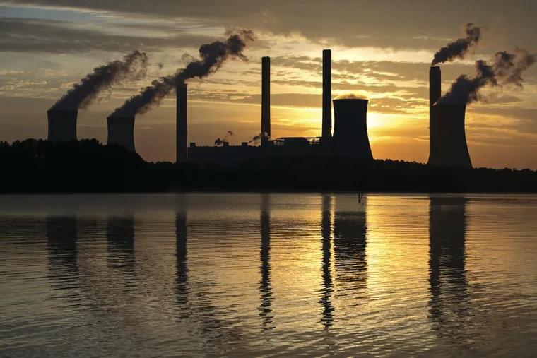 FILE –  Coal-fired Plant Scherer, Juliette, Ga. (AP Photo/Branden Camp, File)