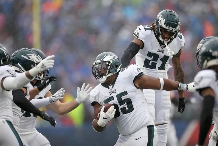 Eagles defensive end Brandon Graham (55) celebrates with cornerback Ronald Darby (21) after Graham recovered a fumble during the second quarter.
