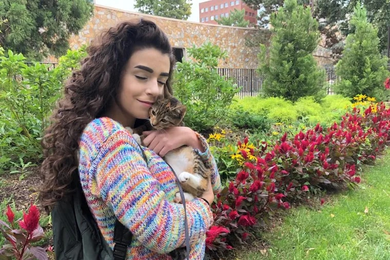 Temple sophomore Liv Tempesta with her cat, Luna. Last year, Tempesta lived on campus with her other cat, Skittles, who served as her emotional-support animal and was a treatment for depression and anxiety.