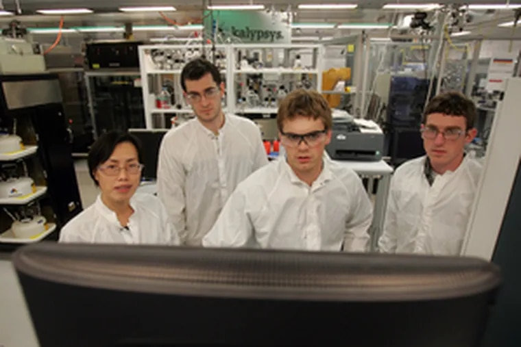 Biologists (from left) Yaping Liu, Greg O'Donnell, Patrick Mattern and Dan Riley review data in an automated technology lab at Merck in North Wales.