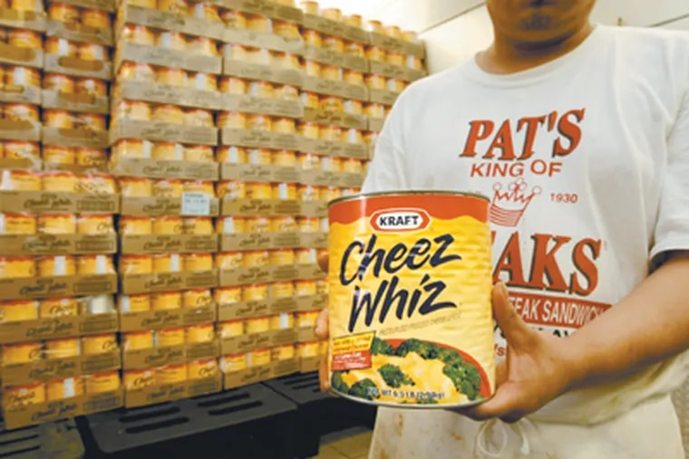 Pat's King of Steaks keeps about 300 cans of Kraft Cheez Whiz seen here at the restaurant . Each can is 6.5 lb. 5-22-08. (Michael S. Wirtz / Inquirer).