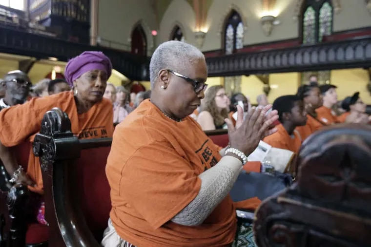 """Catherine Joy Songster (center) mother of Kempis 'Ghani' Songster attended the """"Community Resentencing"""" at the Arch Street Methodist Church in Philadelphia."""