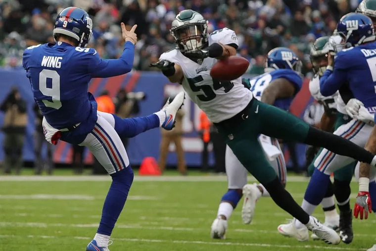 Eagles' Kamu Grugier-Hill, right, blocks a punt by the Giants' Brad Wing in the 2nd quarter as the Philadelphia Eagles play the New York Giants in East Rutherford, New Jersey on Sunday.