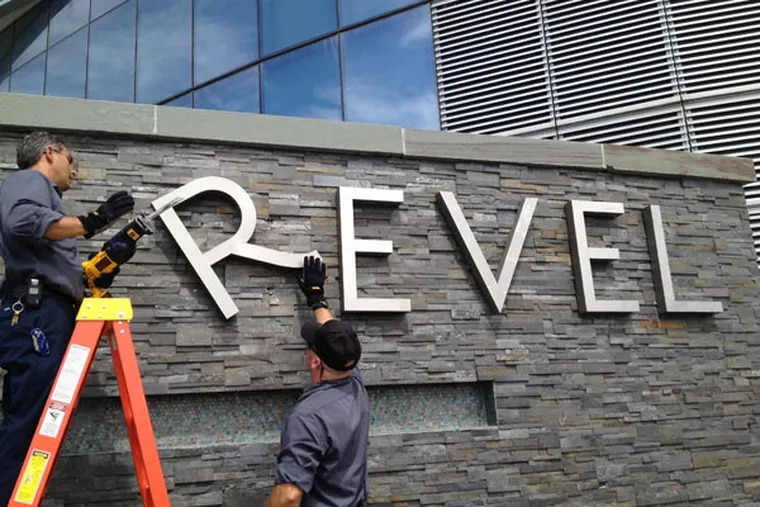 Revel employees Joe Lucchetti, of Turnersville, N.J., left, and Robert Fitting, of Berlin, N.J. remove letters from a sign at Revel hotel-casino, Monday, Sept. 1, 2014, in Atlantic City, N.J. The hotel closed Monday and the casino will close on Tuesday. (AP Photo / The Press of Atlantic City, Michael Ein)
