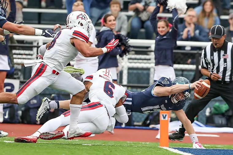 Villanova quarterback Daniel Smith dives in to the end zone for a touchdown in 2019.