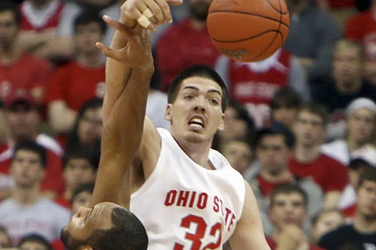 Ohio State's B.J. Mullens, shown battling for rebound with Northwestern's Kyle Rowley, will work out for Sixers. (AP Photo)
