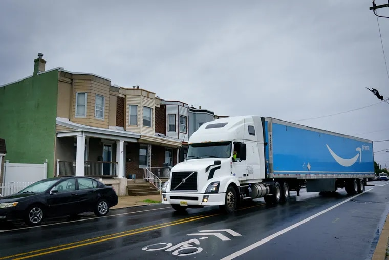 A truck from the Amazon Warehouse pulls onto the 4200 block of Richmond Street in Philadelphia.