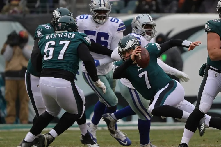 Philadelphia Eagles quarterback Nate Sudfeld slips as he tries to run during the second quarter against the Dallas Cowboys.
