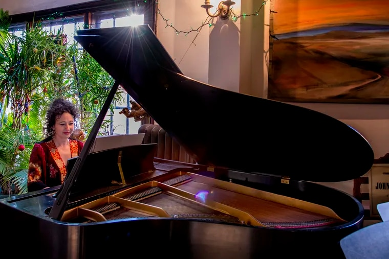 Composer Andrea Clearfield playing piano at home in Philly.