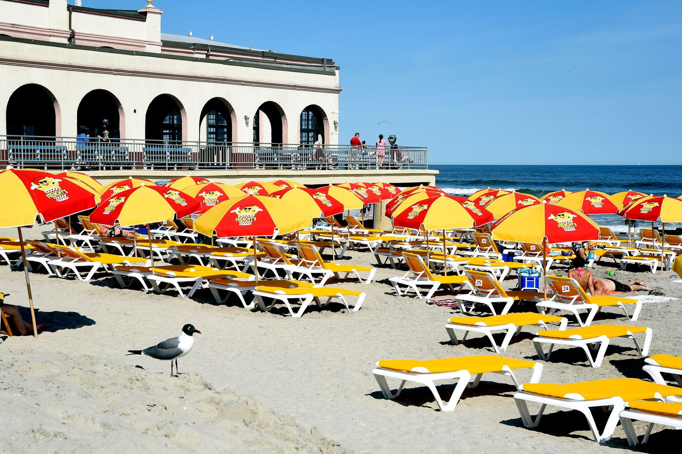 Umbrella wars erupt in Ocean City as Frenchy's french fry company lays claim to beach near Music Pier