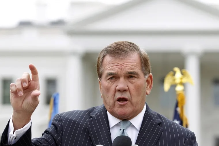 Former Secretary of Homeland Security Tom Ridge speaks to a crowd of hundreds protesting in front of the White House in 2011. (AP Photo/Jose Luis Magana)