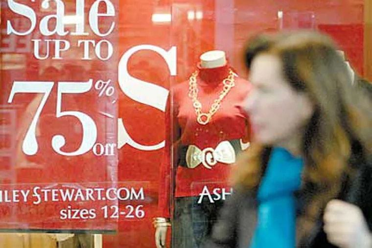 Discounts at an Ashley Stewart store at the Cherry Hill Mall were typical of post-Christmas efforts to lure shoppers. (Jonathan Wilson / Staff Photographer)
