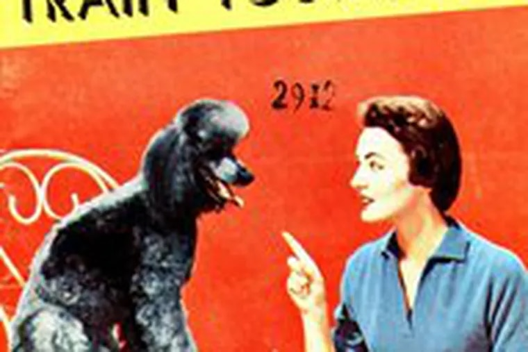"""The cover of a 1957 dog training manual, from the exhibit """"Pets in America"""" at Winterthur Museum & Country Estate to Jan. 20."""