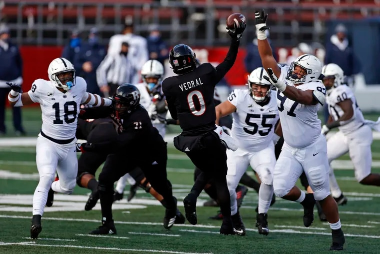 Penn State defensive tackle PJ Mustipher (97) pressures Rutgers quarterback Noah Vedral (0) during the second half of an NCAA college football game Saturday, Dec. 5, 2020, in Piscataway, N.J.  (AP Photo/Adam Hunger)
