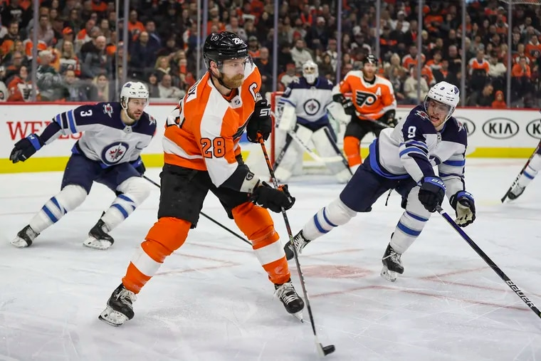 Flyers left winger Claude Giroux (28) stickhandles past the Winnipeg Jets in a Feb. 22 game last season. Giroux is trying to bounce back from a postseason in which he had just one goal in 16 games.