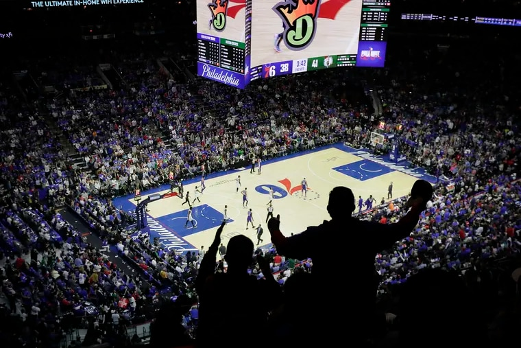 Sixers fans cheer in the first half of a Sixers game in October.