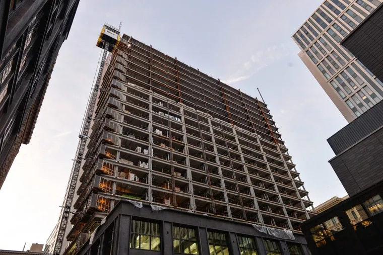 The residential tower under construction in November 2017 will be part of the East Market mixed-use development. With a healthy real estate market, the 10-year tax abatement benefit only flows to developers.