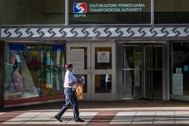 SEPTA employee walks in front of headquarters at 1234 Market St. in Center City. SEPTA's board has approved a $500,000 contract increase for the SEPTA Key system.