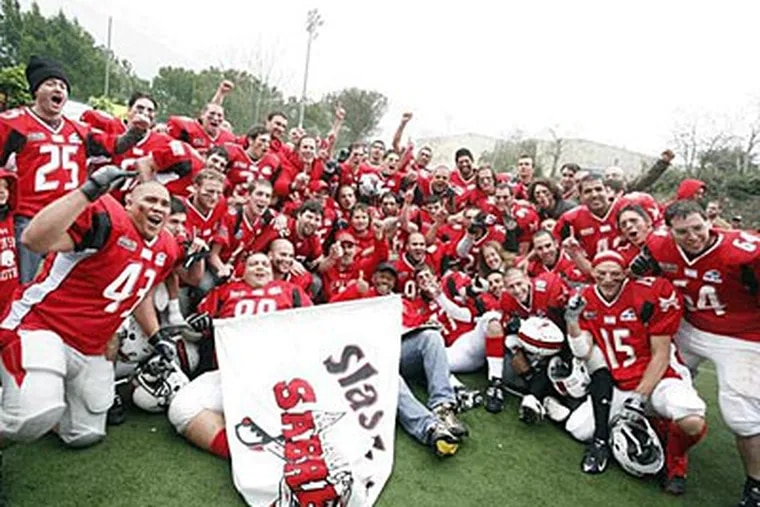 Tel Aviv-Jaffa Sabres celebrate 26-22 championship win over Jerusalem in March of this year.