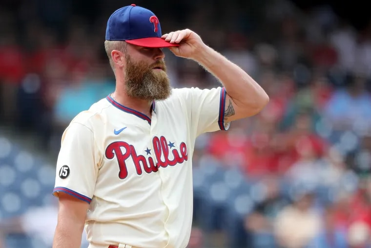 Phillies relief pitcher Archie Bradley reacts after giving up two runs in the eighth inning Sunday.