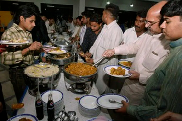 A wedding party in Lahore . A law to cut costs has been enforced sporadically, probably because it runs against strong tradition.