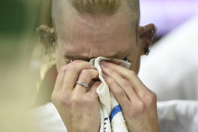 An emotional Molly Schuyler wipes her eyes after winning Sportsradio 94 WIP's 26th annual Wing Bowl.