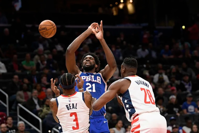 Sixers center Joel Embiid (21) loses the ball after he was fouled by Washington Wizards guard Bradley Beal (3) during the first half.