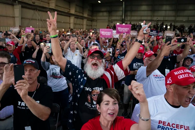 Trump supporters cheer as he arrives last Thursday at Arnold Palmer Regional Airport in Latrobe, Pa.