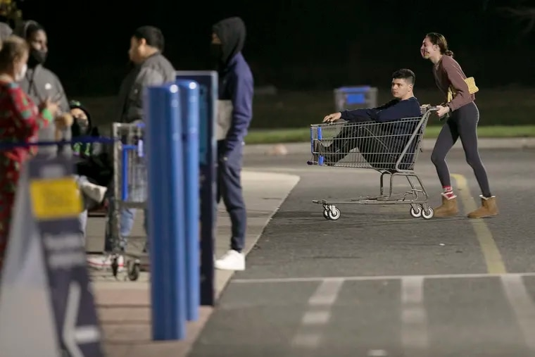 Shortly after 2 am Kimberly Stephens of Wash. Twp. pushes Andrew Rafter of Clementon in the shopping cart and into the line so they can be eady for when this Walmart on Clements Bridge Rd. in Deptford, N.J. opens at 5 am on Black Friday November 27, 2020. The coronavirus (COVID19) and the social distancing needed to combat the pandemic have changed the retail landscape.