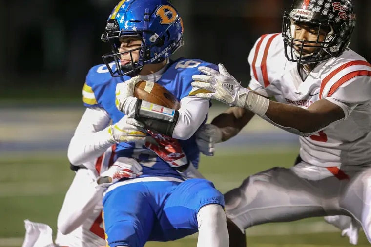 Downingtown West's Alex Rosano (left) and Coatesville's Abdul Stewart collide during the District 1 Class 6A football championship game on Nov. 22, 2019. Both schools are members of the Ches-Mont League, which on Friday announced plans to suspend fall sports because of the coronavirus outbreak.