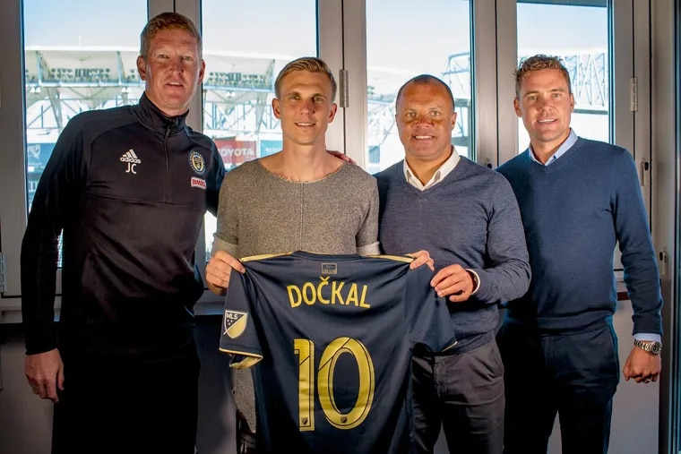 New Philadelphia Union midfielder Borek Dockal (center left) poses with his new jersey and (from left to right) manager Jim Curtin, sporting director Earnie Stewart and technical director Chris Albright.