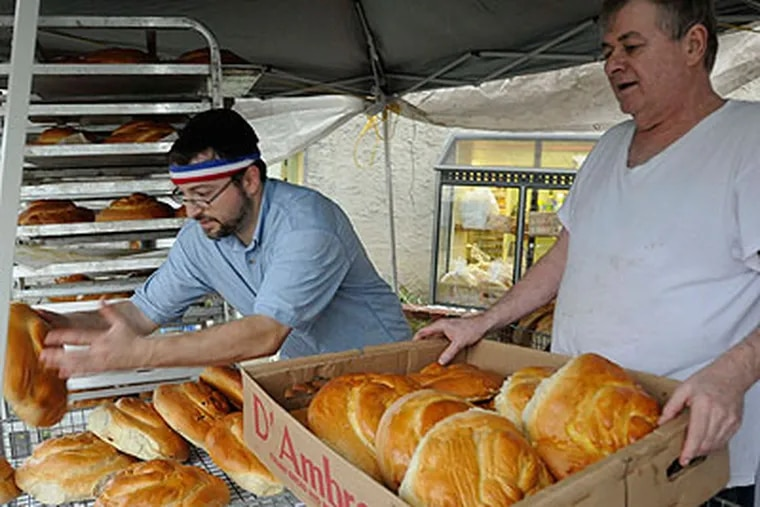 Israel Roling (left) and his father Sam Roling, co-owners of Rolling's Bakery, prepare challah breads for customers. (Ron Tarver / Staff Photographer)